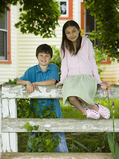 Stock Photo: 1660R-27241 Portrait of a girl and a boy smiling