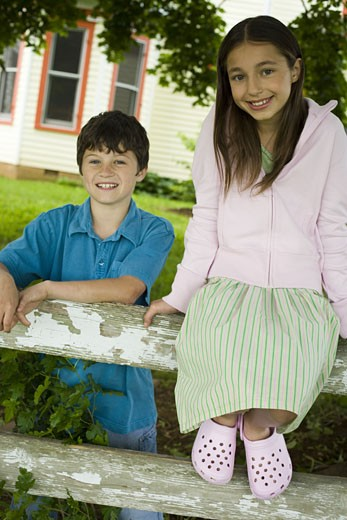 Stock Photo: 1660R-27246 Portrait of a girl and a boy smiling