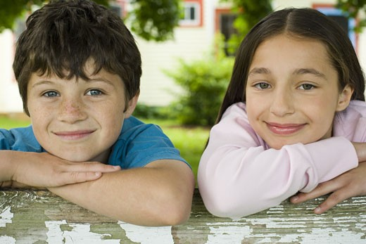 Stock Photo: 1660R-27251 Close-up of a boy and a girl smiling