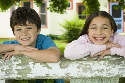 Stock Photo: 1660R-27254 Portrait of a boy and a girl smiling