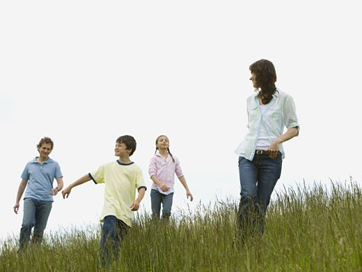 Stock Photo: 1660R-27330 Low angle view of a woman and a man with their son and daughter in a field