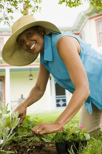 Senior woman digging with a trowel : Stock Photo