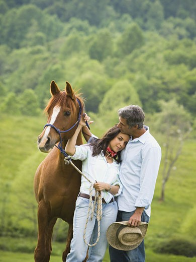 Stock Photo: 1660R-27565 man and a woman standing with a horse