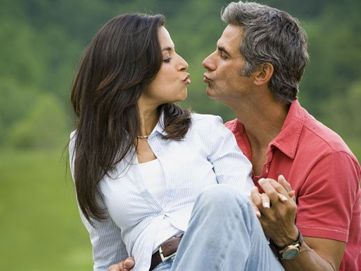 Stock Photo: 1660R-27618 Close-up of a man and a woman kissing each other