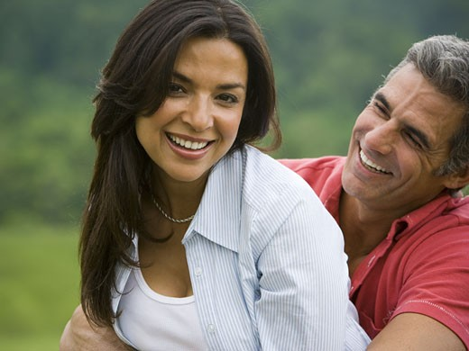 Close-up of a man and a woman smiling : Stock Photo