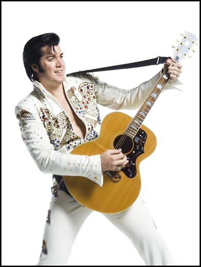 Stock Photo: 1660R-27685 An Elvis impersonator playing the guitar