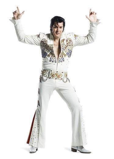 Stock Photo: 1660R-27691 An Elvis impersonator dancing