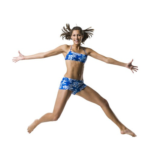 Stock Photo: 1660R-27710 A young woman jumping