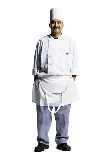 Stock Photo: 1660R-2784 Portrait of a male chef standing with his hands in his pockets