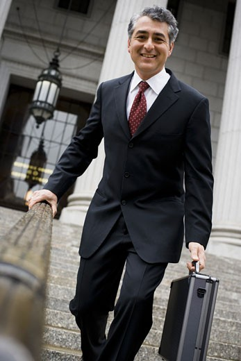 Stock Photo: 1660R-27861 Low angle view of a man walking down the steps of a courthouse