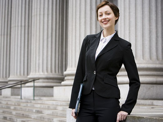 Portrait of a female lawyer smiling : Stock Photo