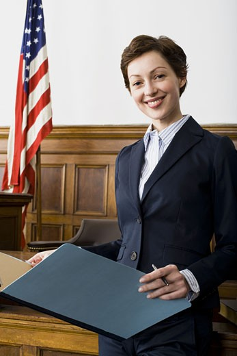 Portrait of a female lawyer standing in a courtroom : Stock Photo