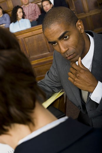 Stock Photo: 1660R-27930 High angle view of a male lawyer in a courtroom during a trial