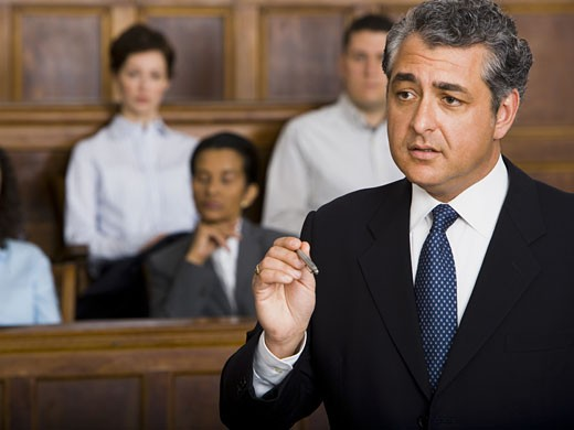 Stock Photo: 1660R-27938 A male lawyer talking in a courtroom