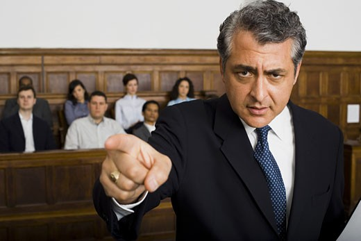 Portrait of a male lawyer pointing : Stock Photo