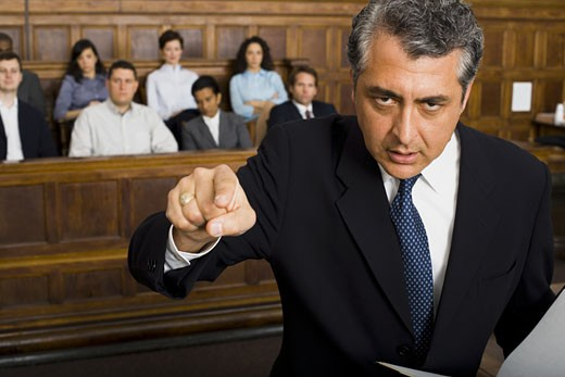 Stock Photo: 1660R-27943 Portrait of a male lawyer pointing