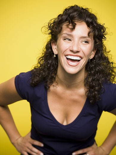Stock Photo: 1660R-27968 A young woman laughing