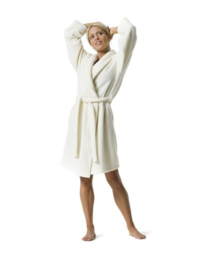 Stock Photo: 1660R-28123 Portrait of a young woman standing in bathrobe