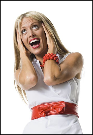 Stock Photo: 1660R-28133 Close-up of a young woman looking surprised with her head in her hands