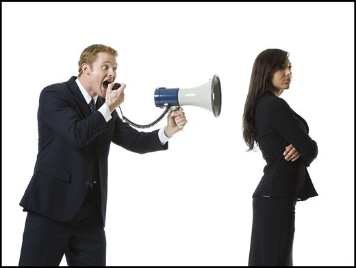 Stock Photo: 1660R-28170 Profile of a businessman shouting into a megaphone with a teenage girl back
