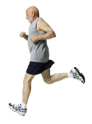 Profile of a senior man jogging : Stock Photo