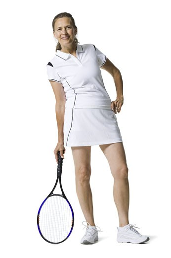 Stock Photo: 1660R-28245 Portrait of a senior woman holding a tennis racket and smiling