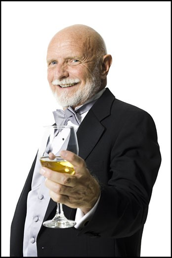 Portrait of a senior man holding a glass of wine : Stock Photo