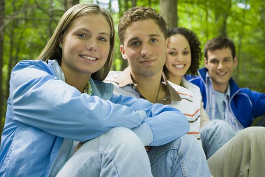 Stock Photo: 1660R-28293 Portrait of two young women and two young men sitting and smiling