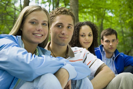 Stock Photo: 1660R-28294 Portrait of two young women and two young men sitting and smiling