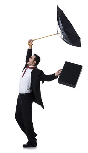 Stock Photo: 1660R-28446 Profile of a businessman holding an umbrella and jumping