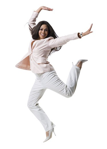 Portrait of a young woman jumping : Stock Photo