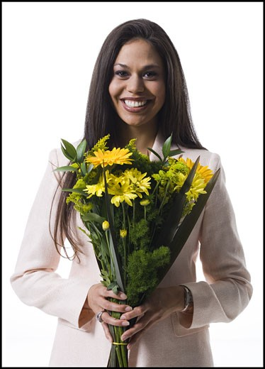 Stock Photo: 1660R-28455 Portrait of a young woman holding a bouquet of flowers and smiling