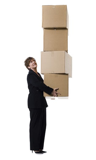 Stock Photo: 1660R-28463 Profile of a senior woman holding a stack of cardboard boxes