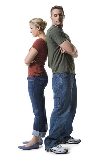 Profile of a young couple standing back to back : Stock Photo