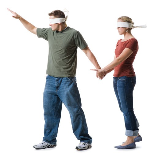 Stock Photo: 1660R-28469 Blindfolded young man leading to a blindfolded young woman