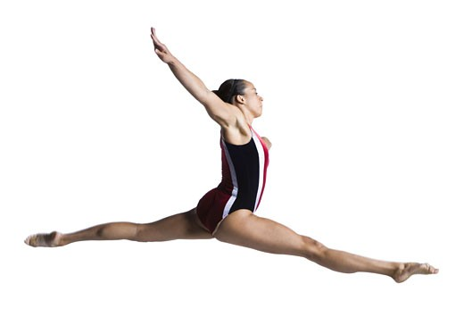 Female gymnast doing floor exercises : Stock Photo