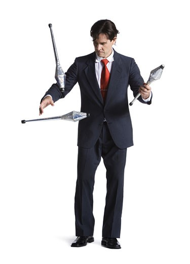 Businessman juggling pins : Stock Photo