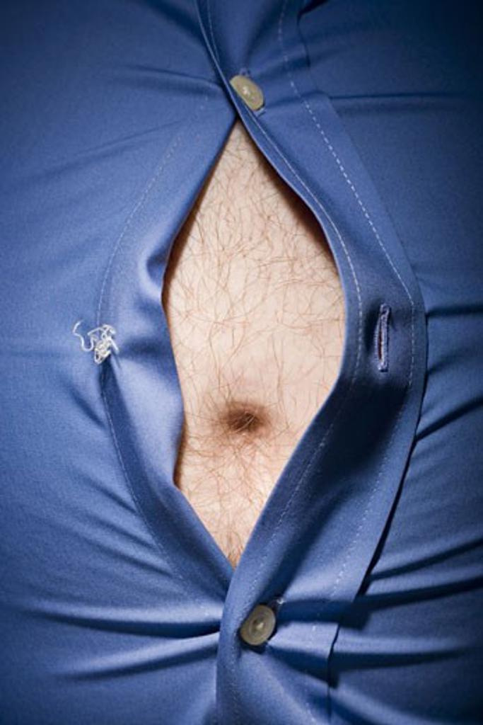 Stock Photo: 1660R-28787 Close-up of fat stomach bursting through shirt