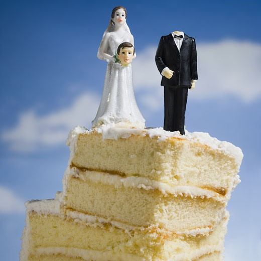 Stock Photo: 1660R-28816 Wedding cake visual metaphor with figurine cake toppers