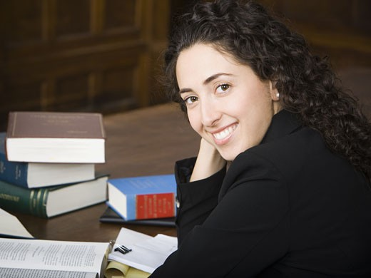 Stock Photo: 1660R-28901 Female lawyer smiling in courtroom