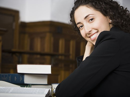 Stock Photo: 1660R-28902 Female lawyer smiling in courtroom