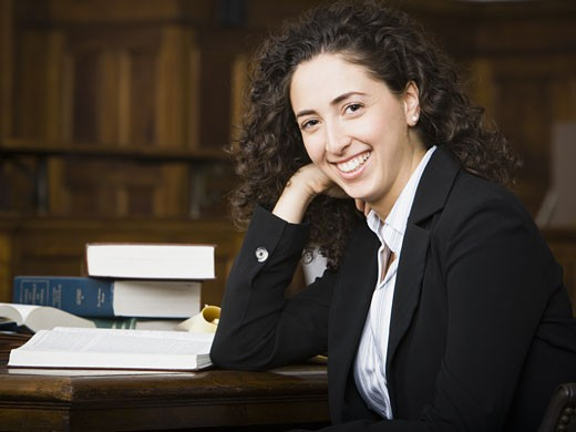 Stock Photo: 1660R-28903 Female lawyer smiling in courtroom