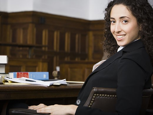 Stock Photo: 1660R-28904 Female lawyer smiling in courtroom