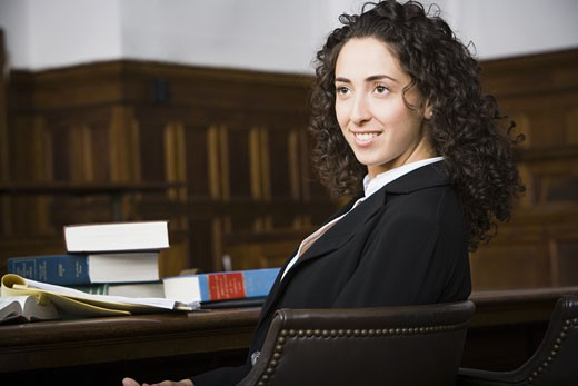 Female lawyer smiling in courtroom : Stock Photo