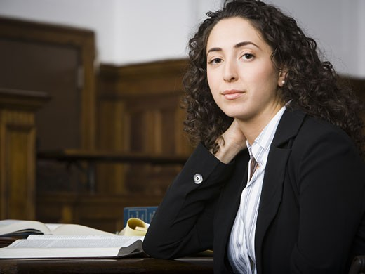 Stock Photo: 1660R-28906 Female lawyer smiling in courtroom