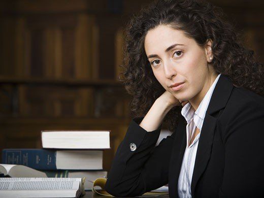Stock Photo: 1660R-28907 Female lawyer smiling in courtroom