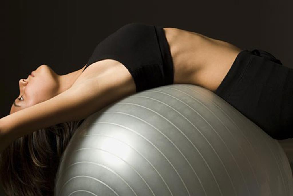Woman performing Pilates exercises : Stock Photo