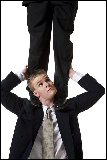 Stock Photo: 1660R-28998 Businessman supporting colleague on shoulders
