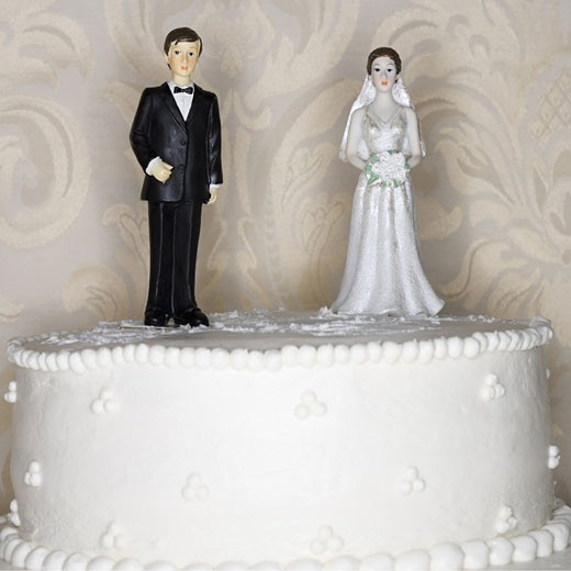 Stock Photo: 1660R-29039 Wedding cake visual metaphor with figurine cake toppers
