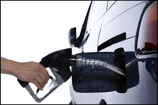 Stock Photo: 1660R-29134 Filling up gas tank